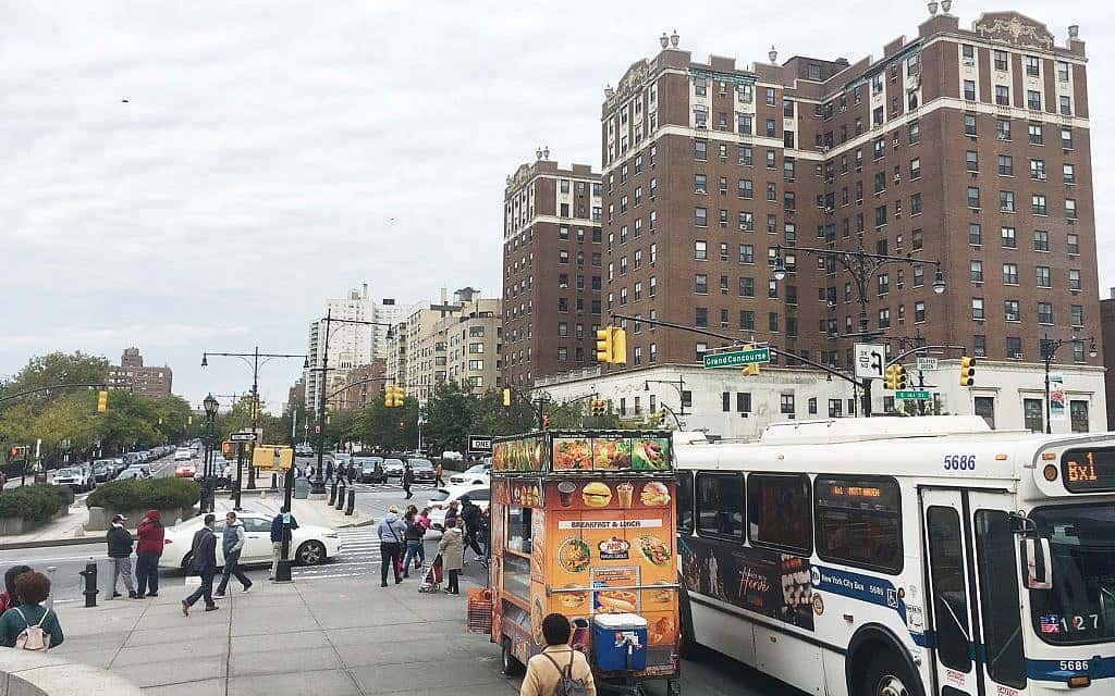 First Up Cleaing Services serves Bronx, New York with large buildings, food cart, and bus at bus stop