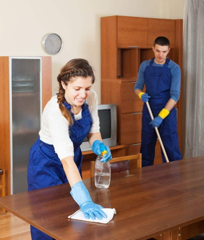 First Up Cleaning Services cleaners sanitizing surfaces in office